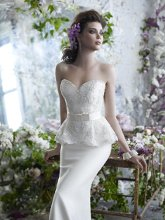 StyleTK2255 Ivory Mikado organza trumpet bridal gown with beaded and embroidered peplum bodice, satin ribbon belt with tailored bow at natural waist, and sweep train.