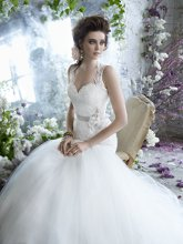 Styletk2258 <br /> <br /> Ivory Alencon lace bridal ball gown, elongated bodice with keyhole back, floral belt at natural waist, full tulle skirt and sweep train