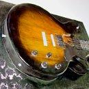 130x130 sq 1353270296289 guitar