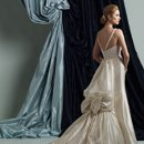 Style #J21116 Sleeveless mystique organza slim A-line gown with plunging V-neckline, Empire bodice encrusted with intricate hand-beading and fine embroidery, V-back beaded shoulder straps, back bustle with dramatic bow detail and cascading streamers with beaded trim, sweep train.