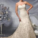 Style No. J1824 Strapless allover re-embroidered lace, satin and illusion A-line gown accented with Swarovski crystals, soft sweetheart neckline, skirt with scalloped trim, satin hemline, and chapel length train.