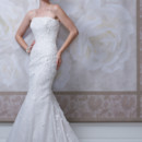 Style #J11440 Strapless allover lace, three-dimensional Venise lace appliqué and sequin over satin modified mermaid gown with dropped waistline, low curved back bodice, scalloped hemline and chapel length train. Detachable spaghetti and halter straps included. Featured matching veil.