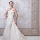 Style #j11447 Strapless hand-beaded lace, tulle and memory taffeta slim A-line cage dress with scalloped sweetheart neckline, softly curved back bodice, dropped waistline, scalloped hemline, sweep train, detachable memory taffeta chapel length train with hand-crafted flowers at the top.