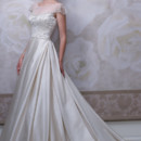 Style #J11450 <br /> Satin ball gown with hand-beaded illusion bateau neckline and embroidered scalloped short sleeves, natural waist bodice encrusted with richly beaded embroidery features an illusion scoop back bodice with crystal button closures, back box pleated full skirt with chapel length train.
