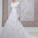 Style #J11455 Lace and tulle ball gown with scalloped lace sheer curved bateau neckline and long sleeves, sweetheart bodice with dropped waistline, deep plunging scalloped back bodice finished with covered buttons, full skirt with scalloped hemline and chapel length train.