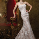 Style No. J21461 2014 Collection – Strapless embroidered Schiffli lace, tulle and organza over satin modified mermaid wedding dress, softly curved neckline trimmed with piping, fully embroidered Schiffli lace bodice, tulle and organza overlay skirt with lace motifs cascading down to chapel length train.