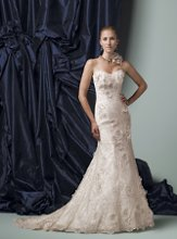 Style #J11170 Strapless all over lace slim A-line gown with sweetheart neckline, Antique lace dress features three-dimensional lace and organza flowers accented with Swarvoksi crystal centers, scalloped hemline extends into chapel length train. Removable straps included.