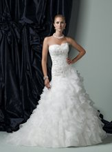 Style #J11177 Strapless organza ball gown with softly curved neckline, beaded re-embroidred lace bodice accented with three-dimensional lace flowers, asymmetrical dropped waistline, multi-tiered full ruffle skirt with chapel length train. Removable straps included.