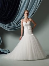 Style #J21118 Strapless dotted tulle full ball gown with sweetheart neckline, directionally ruched bodice with dropped waistline, satin self-tie ribbon belt accented with dramatic three-dimensional beaded flower at natural waist, full skirt with chapel length train. Detachable spaghetti and halter straps included.