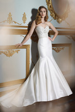 Style J21322 <br /> Strapless Mikado mermaid gown with sweetheart neckline, softly curved back bodice features covered buttons down mid back, elaborate delicately hand-beaded Empire bodice accented with Swarovski crystals, chapel length train, detachable spaghetti and halter straps included.