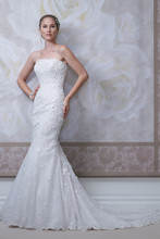 Style #J11440 <br /> Strapless allover lace, three-dimensional Venise lace appliqué and sequin over satin modified mermaid gown with dropped waistline, low curved back bodice, scalloped hemline and chapel length train. Detachable spaghetti and halter straps included. Featured matching veil.