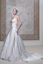 Style #J11444 <br /> Strapless satin and lace ball gown, lace bodice features hand-beaded scalloped sweetheart neckline and natural waistline, curved back bodice, gently gathered skirt features lace accents, scalloped hemline and chapel length train.