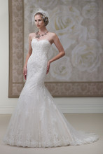 Style #J11445  <br /> Strapless hand-beaded lace and tulle modified mermaid gown with scalloped sweetheart neckline, dropped waistline, scalloped hemline and chapel length train.
