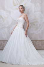 Style #J11452S <br /> Strapless silk taffeta ball gown with sweetheart neckline, bodice encrusted with hand-beaded embroidery also features a scalloped natural waistline, gathered full skirt with chapel length train.