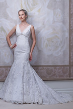 Style #J11453 <br /> Sleeveless lace and tulle mermaid gown features a V-neckline trimmed in tulle, hand-beaded accents at inverted empire waist, dropped waistline, deep V-back neckline finished with covered buttons, scalloped hemline with chapel length train.