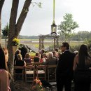 Driftwood arbor during ceremony. Waterfront view Charleston SC