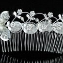 130x130_sq_1314903005233-whiteflowerpearlhaircomb