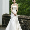 Style #3622 A gorgeous, slim line regal satin strapless dress has a lace-up back and a sweep train.