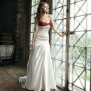 Style #3669 Strapless regal satin with bias band with a twist to create a soft sweetheart, asymmetrical draped mermaid with buttons on zipper and bow and streamers in chapel train.