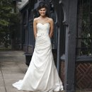 Style #3725 An asymmetric pleated satin A-line gown with a pleated sweetheart neckline. Buttons cover the zipper and this style has a chapel length train. Comes with a detachable belt with flowers and beading.