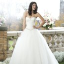Preview 2014 Style 3765 The sweetheart neckline and basque waistline are adorned by beaded trim over a lace bodice that sits on a full gathered tulle skirt. The gown ends with a chapel length train and tulle buttons that cover the back zipper.