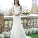 Preview 2014 Style 3759 The fit and flare beaded lace and tulle gown has an elegant V-neckline and three quarter length sleeves. The back of the bodice and chapel length train are embellished by satin buttons and lace appliques.