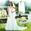 Preview 2014 Style 3751 Circular cut chiffon gown has a lace V neckline with a pleated chiffon cummerbund. This gown has a sweep length train and chiffon buttons that cover the back zipper.