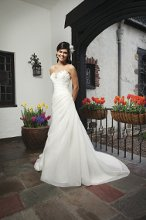 Style #3726 An asymmetric organza draped A-line gown with a beaded sweetheart neckline. This style has a lace up back and a chapel length train.