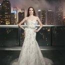 9701 Dimensional lace and tulle fit and flair, with a sweetheart neckline and a chapel length train. A satin detachable beaded belt is included. Buttons cover the back zipper and finish at the dropped waist.