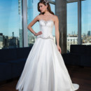 Style # 9748 Silk dupion circular ball gown featuring heavily hand beaded trim at soft sweetheart neckline and scalloped basque waist. The gown is finished with silk dupion and crystal buttons that extend to the hem of the chapel length train.