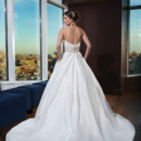 Style # 9752 Silk Dupion ballgown with a chevron pleated bodice, sweetheart neckline and hand beaded moon stone cummerbund on a circular cut ball gown. The gown is finished with pockets and silk dupion and crystal buttons to the end of the chapel length train.