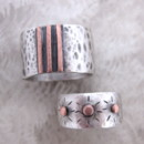 Custom 25th wedding anniversary bands. Sterling silver with copper inlay.