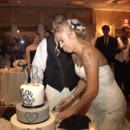 130x130 sq 1386132669137 cake cutting 0