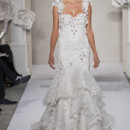 Sweetheart Mermaid Gown in French Lace This mermaid gown features a sweetheart neckline with a natural waist in french lace and beaded lace. It has a chapel train and a tank top. This gown is Exclusive to Kleinfeld Bridal. Style Number:32637522