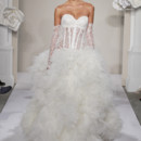 Sweetheart A-Line Gown in Beaded Embroidery This a-line gown features a sweetheart neckline with a dropped waist in beaded embroidery and tulle. It has a cathedral train. This gown is Exclusive to Kleinfeld Bridal. Style Number:32614307