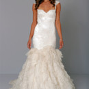 Sweetheart Mermaid Gown in Satin This mermaid gown features a sweetheart neckline with a dropped waist in satin and silk organza. It has a chapel train and cap sleeves. This gown is Exclusive to Kleinfeld Bridal. Style Number:32617342