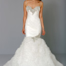 Sweetheart Mermaid Gown in Organza This mermaid gown features a sweetheart neckline with a dropped waist in organza and beaded embroidery. It has a chapel train and spaghetti straps. This gown is Exclusive to Kleinfeld Bridal. Style Number:32659955