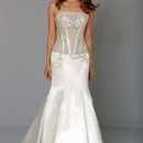 Strapless Mermaid Gown in Satin This mermaid gown features a strapless neckline with a dropped waist in satin and beaded embroidery. It has a chapel train. This gown is Exclusive to Kleinfeld Bridal. Style Number:32711020