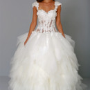 Sweetheart Ball Gown in Tulle This ball gown features a sweetheart neckline with a dropped waist in tulle and silk. It has a chapel train and cap sleeves. This gown is Exclusive to Kleinfeld Bridal. Style Number:32711053