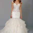 Sweetheart Mermaid Gown in Silk Organza This mermaid gown features a sweetheart neckline with a dropped waist in silk organza and beaded embroidery. It has a chapel train and cap sleeves. This gown is Exclusive to Kleinfeld Bridal. Style Number:32711012