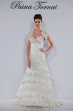 Style 4142 This mermaid gown features a sweetheart neckline with a dropped waist in beaded embroidery and beaded lace. It has a chapel train. This gown is Exclusive to Kleinfeld Bridal. Retail Price: $19,500