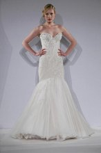 Mark Zunino MZBS1208 Illusion over silk crepe with hand beaded swirls of crystals and pearls cascading onto multi layered mermaid hem