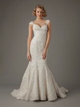 MZ2 by Mark Zunino Sweetheart Mermaid Gown in Lace This mermaid gown features a sweetheart neckline with in lace. It has a chapel train and cap sleeves. This gown is Exclusive to Kleinfeld Bridal. Style Number: 74510