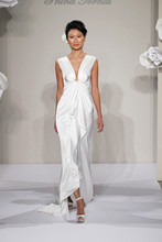 V-Neck Sheath Gown in Silk Charmeuse This sheath gown features a v-neck neckline with an empire waist in silk charmeuse. It has a chapel train and a tank top. This gown is Exclusive to Kleinfeld Bridal. Style Number:32614323