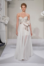 Sweetheart A-Line Gown in Silk Chiffon This a-line gown features a sweetheart neckline with a natural waist in silk chiffon and beaded embroidery. It has a chapel train. This gown is Exclusive to Kleinfeld Bridal. Style Number:32614364