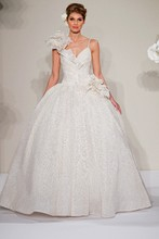 Sweetheart Ball Gown in Silk This ball gown features a sweetheart neckline with a natural waist in silk. It has a chapel train and spaghetti straps. This gown is Exclusive to Kleinfeld Bridal. Style Number:32614380