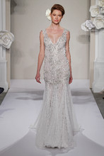 V-Neck Sheath Gown in Silk Chiffon This sheath gown features a v-neck neckline with a dropped waist in silk chiffon and beaded embroidery. It has a chapel train and a tank top. This gown is Exclusive to Kleinfeld Bridal. Style Number:32637514