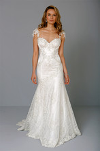 Sweetheart Mermaid Gown in Beaded Lace This mermaid gown features a sweetheart neckline with in beaded lace. It has a chapel train and cap sleeves. This gown is Exclusive to Kleinfeld Bridal. Style Number:32727307