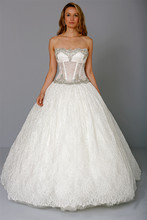 Strapless Ball Gown in Lace This ball gown features a strapless neckline with a natural waist in lace and beaded embroidery. It has a chapel train. This gown is Exclusive to Kleinfeld Bridal. Style Number:32708950