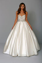 Sweetheart Ball Gown in Satin This ball gown features a sweetheart neckline with a natural waist in satin and beaded embroidery. It has a chapel train. This gown is Exclusive to Kleinfeld Bridal. Style Number:32744161